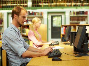 Man uses computer at library